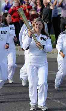 Aimi carries the Olympic Torch in Sheffield