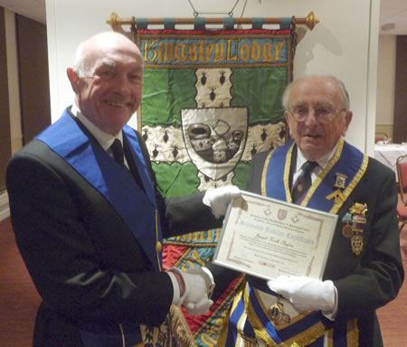 WBro Keith receiving his Diamond Jubilee certificate in 2012