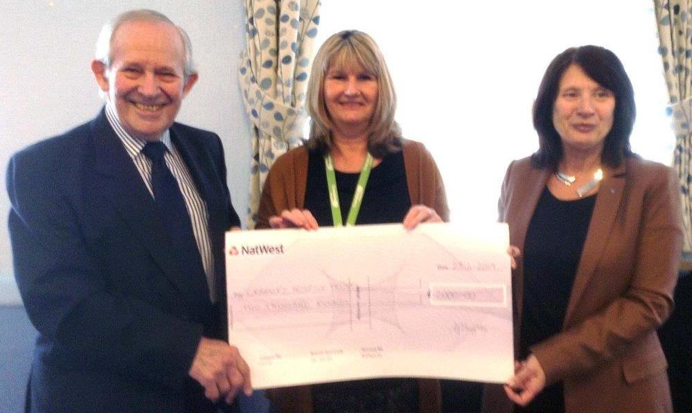 WBro John Rivett PAGDC and Suzy Baxter, Chair of Rushden LAMs, presenting the cheque to Debbie Grant